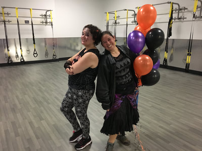 Jessica and Vida pose in their festive Halloween Zumba garb.